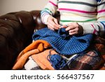 close up of hands knitting   Shutterstock . vector #566437567