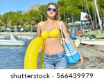 woman with bag and swim ring... | Shutterstock . vector #566439979