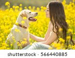 woman and dog on holiday  | Shutterstock . vector #566440885