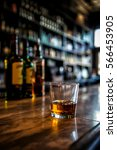 image of a glass of whiskey on... | Shutterstock . vector #566453905