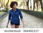 young black woman with afro... | Shutterstock . vector #566481217