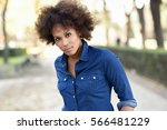 young black woman with afro...   Shutterstock . vector #566481229