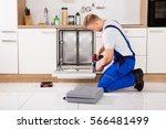 young repairman service worker... | Shutterstock . vector #566481499