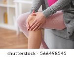 young woman suffering from pain ... | Shutterstock . vector #566498545