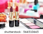 colourful lipsticks on a white... | Shutterstock . vector #566510665