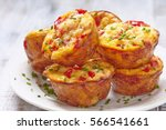 delicious egg muffins with ham  ... | Shutterstock . vector #566541661