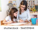 teacher mom working with... | Shutterstock . vector #566559844