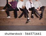young boys sitting on large... | Shutterstock . vector #566571661