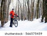 mountain biker with bike on the ...   Shutterstock . vector #566575459