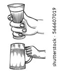 hand holding a full glass of...   Shutterstock .eps vector #566607019