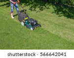woman mowing with lawn mower in ... | Shutterstock . vector #566642041