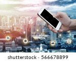 man's hand shows mobile... | Shutterstock . vector #566678899