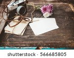 vintage camera with bouquet of... | Shutterstock . vector #566685805