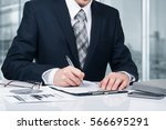 young businessman signing a... | Shutterstock . vector #566695291