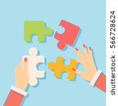 putting puzzle pieces together. ... | Shutterstock .eps vector #566728624