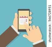 callendar in smartphone. man... | Shutterstock .eps vector #566728951