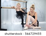mother with the daughter at a...   Shutterstock . vector #566729455