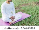 asian man meditating on green... | Shutterstock . vector #566740081