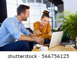 young couple having a business... | Shutterstock . vector #566756125