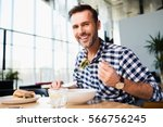 handsome bearded man in checked ... | Shutterstock . vector #566756245