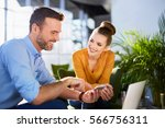 handsome businessman and woman... | Shutterstock . vector #566756311