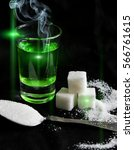 Small photo of absinthe with sugar cubes and spoon flat lay composition