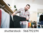 adult man shopping for clothes | Shutterstock . vector #566792194