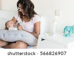 mother with newborn baby in the ... | Shutterstock . vector #566826907