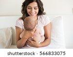 lovely mother holding newborn... | Shutterstock . vector #566833075