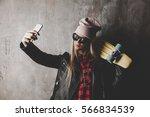 blond teenager girl in black... | Shutterstock . vector #566834539