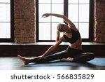 cheerful cute young sportswoman ... | Shutterstock . vector #566835829