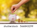 pig bank and stacking gold... | Shutterstock . vector #566843299