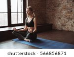 relaxed young sportswoman doing ... | Shutterstock . vector #566856871