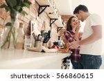 lovely couple in the kitchen | Shutterstock . vector #566860615