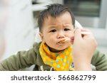 asian baby boy eating blend... | Shutterstock . vector #566862799