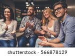 young people are sitting in... | Shutterstock . vector #566878129