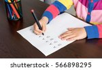 Little Girl Is Practicing Writing Letters - stock photo