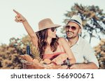 happy young couple going for a... | Shutterstock . vector #566900671