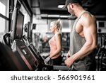 young attractive fit man... | Shutterstock . vector #566901961