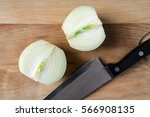 onion cut in two on wooden... | Shutterstock . vector #566908135