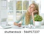 teen girl doing lessons  | Shutterstock . vector #566917237