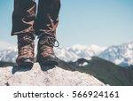 feet trekking boots on rocky... | Shutterstock . vector #566924161
