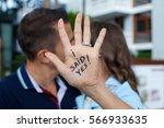 proposal in the street. woman...   Shutterstock . vector #566933635