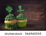 cupcake with clover cakepick on ... | Shutterstock . vector #566960545