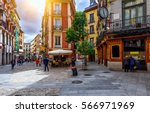 old cozy street in madrid ... | Shutterstock . vector #566971969