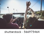 couple driving on a convertible ... | Shutterstock . vector #566975464