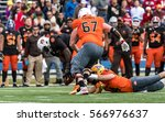 Small photo of Mobile, Alabama, USA. 28th January, 2017: North Team QB (4) Nate Peterman fumbles the ball after being hit by (1) Montravious Adams who recovers the fumble during the Reese's Senior Bowl.