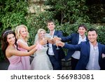 newlyweds and their friends... | Shutterstock . vector #566983081