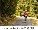middle aged woman riding... | Shutterstock . vector #566992801