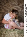 Farm Girl And Kittens Play On...